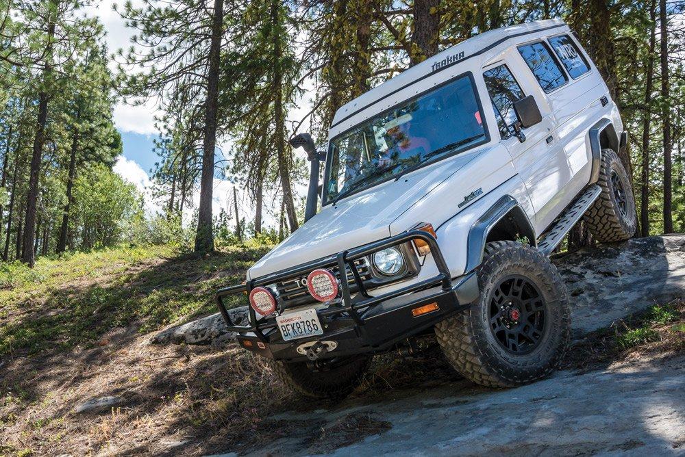Toyota Land Cruiser rock climbing downhill