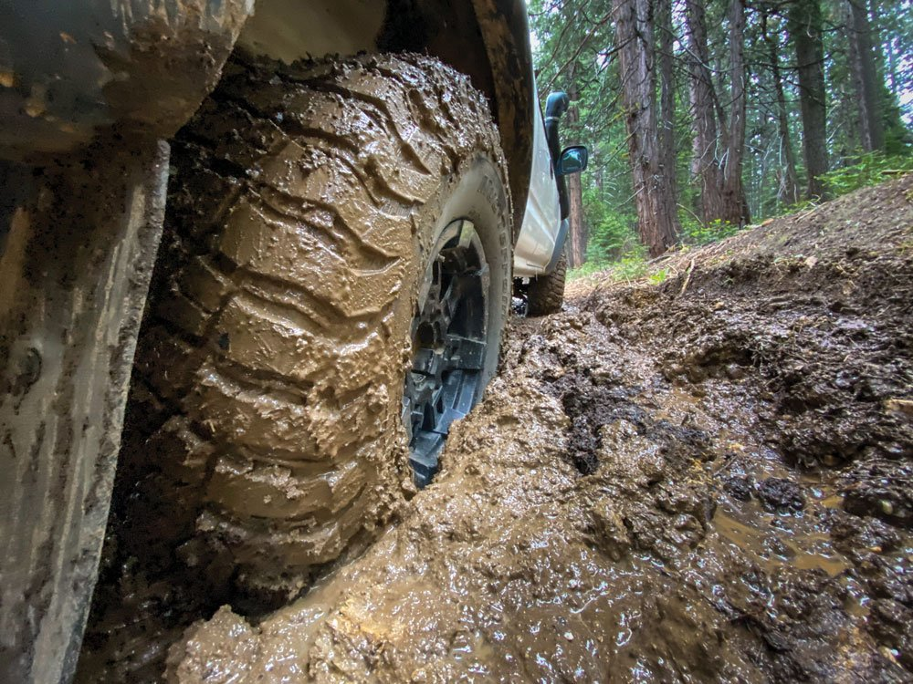 Using a camera phone to shoot the tire stuck in the mud
