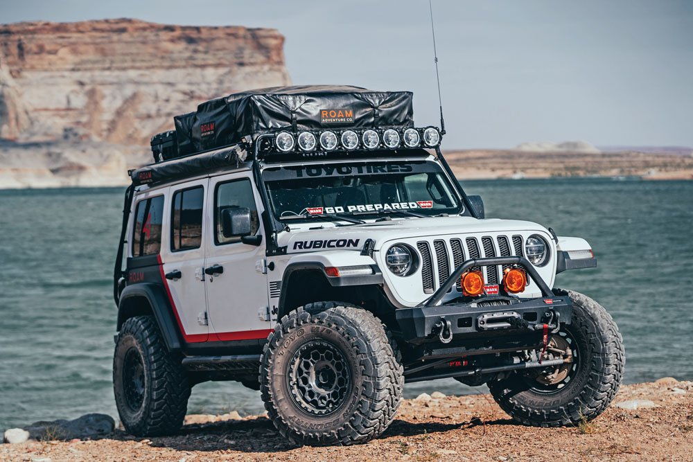The Roam Rubicon posed in front of a lake
