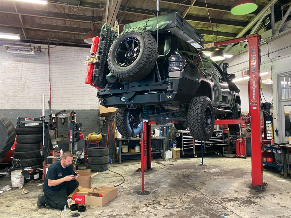 Toyota 4Runner on the lift getting upgraded suspension