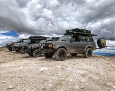 Vehicles all lined up with Veteran Overland for recreational activities
