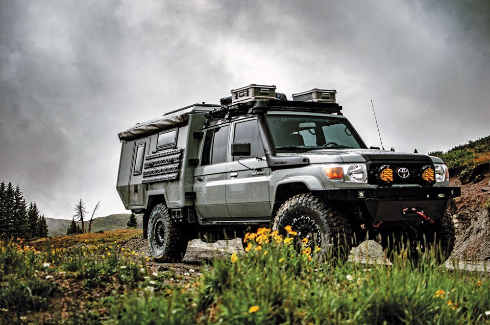 Maltec '93 Land Cruiser 80/79 series parked on side of trail