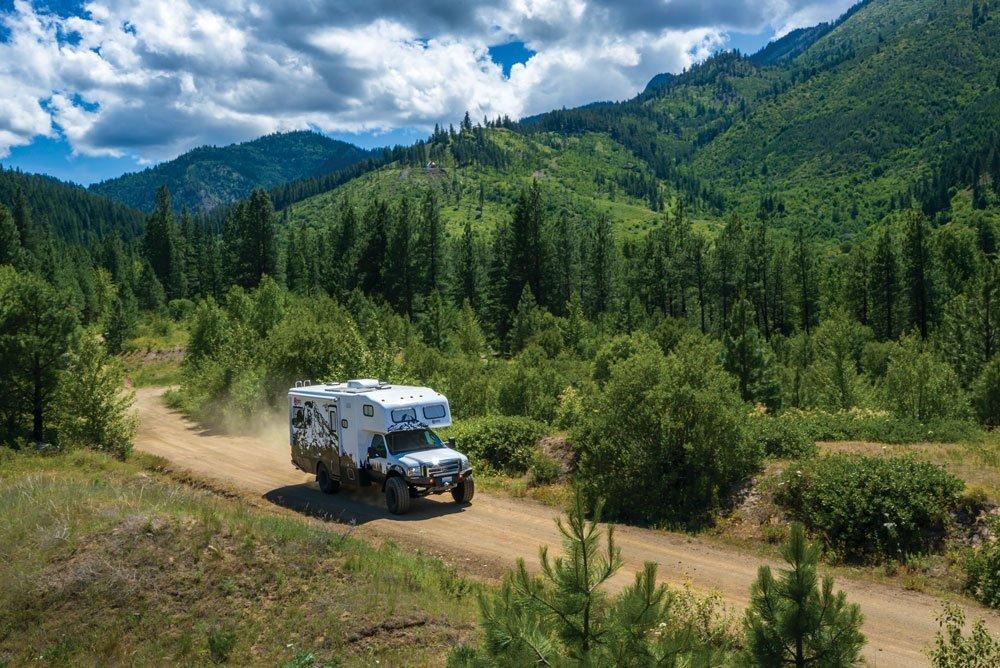 Nitro Gear Ultimate Adventure RV driving along a remote road