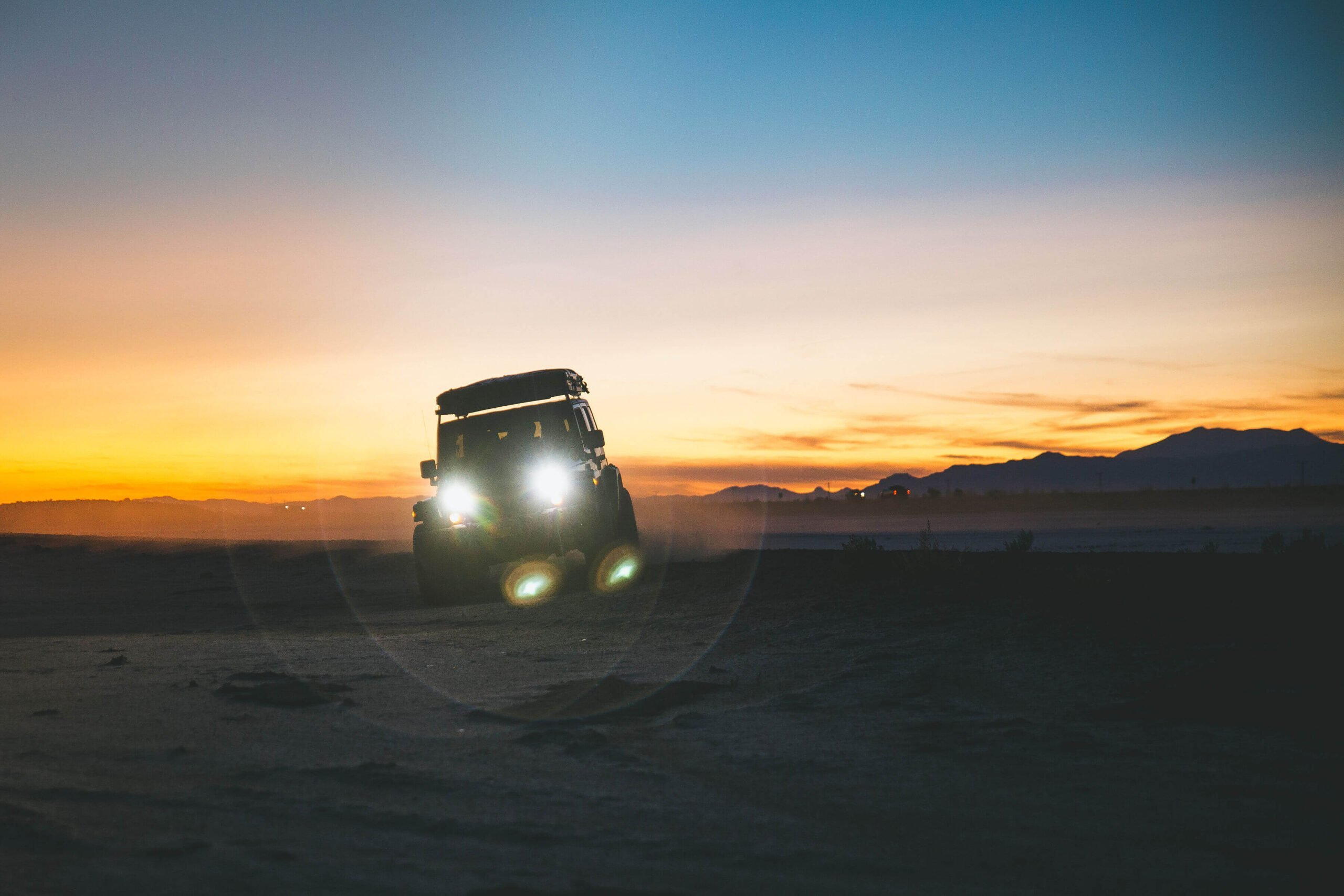 Jeep during sunset in desert