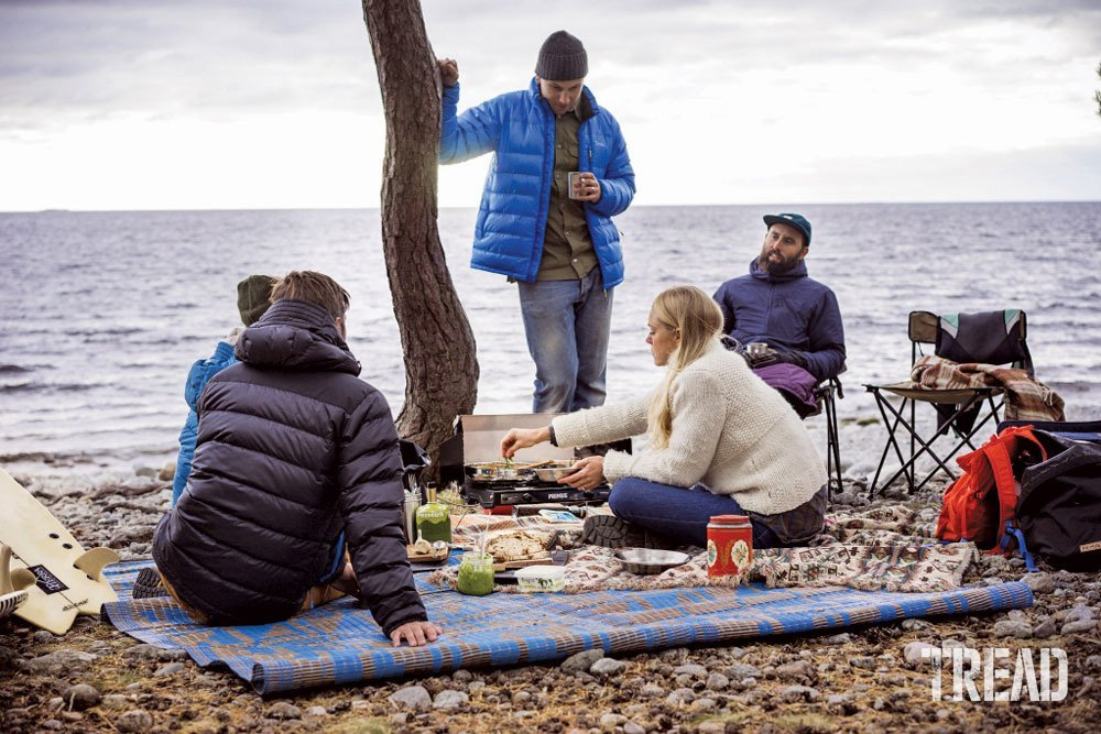 Campers cooking with the Primus Tupike portable stove at beach.
