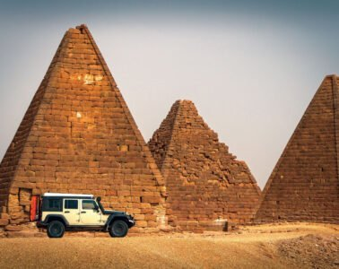 Adventure writer Dan Grec's jeep in front of a temple in Sudan
