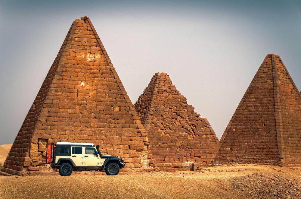 Adventure writer Dan Grec's jeep in front of a temple in Sudan