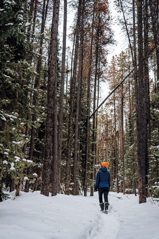 Woman walks in snow in Arctic Canada.