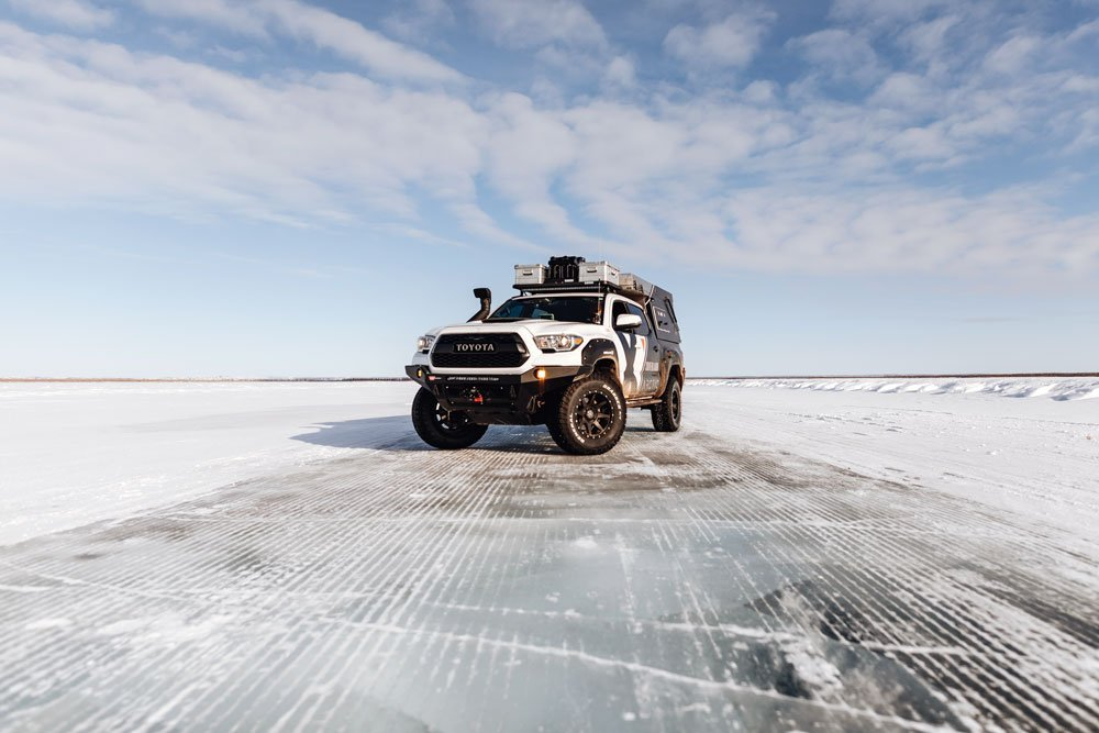 Truck stops on icy road in Arctic Canada.
