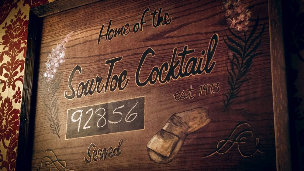"""Sign that says, """"Home of the Sour Toe Cocktail."""""""
