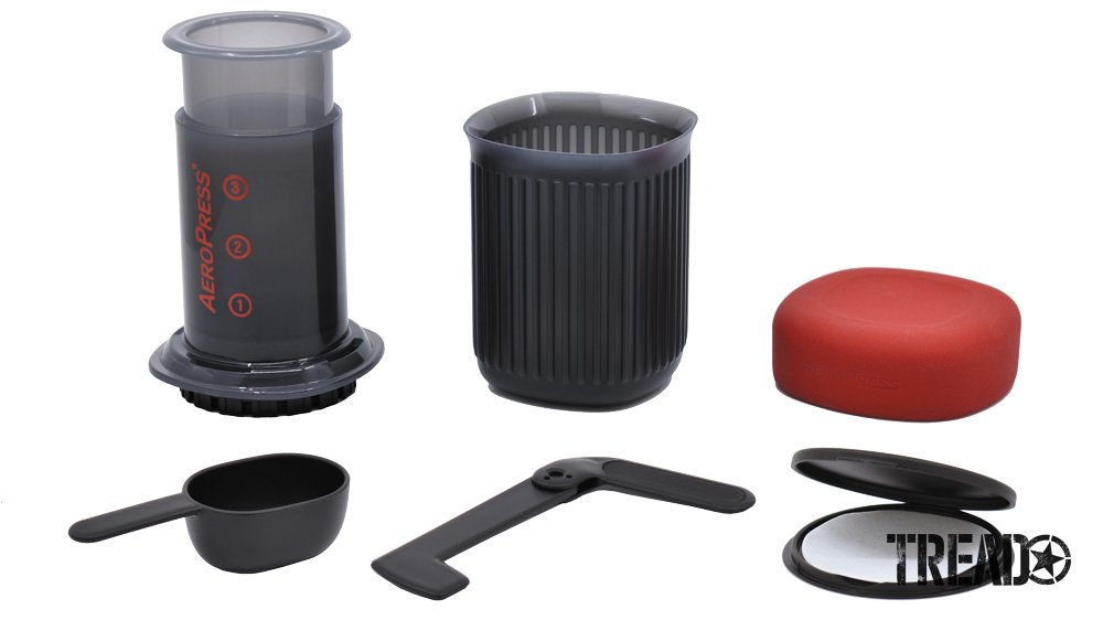 The AeroPress Go contents neatly fit into the dark gray supplied cup and red silicone cover.