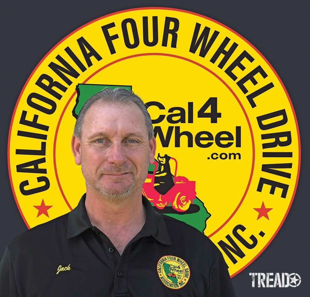 Photo of Jack Chapman, President of the California Four Wheel Drive Association (CA4WDA), with their logo behind him