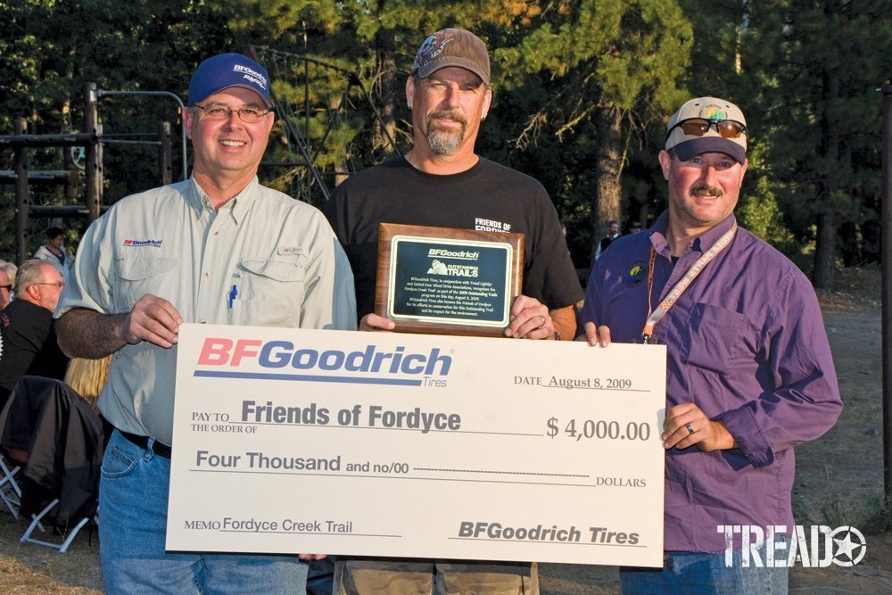 Men holding up a BFGoodrich check for Friends of Fordyce