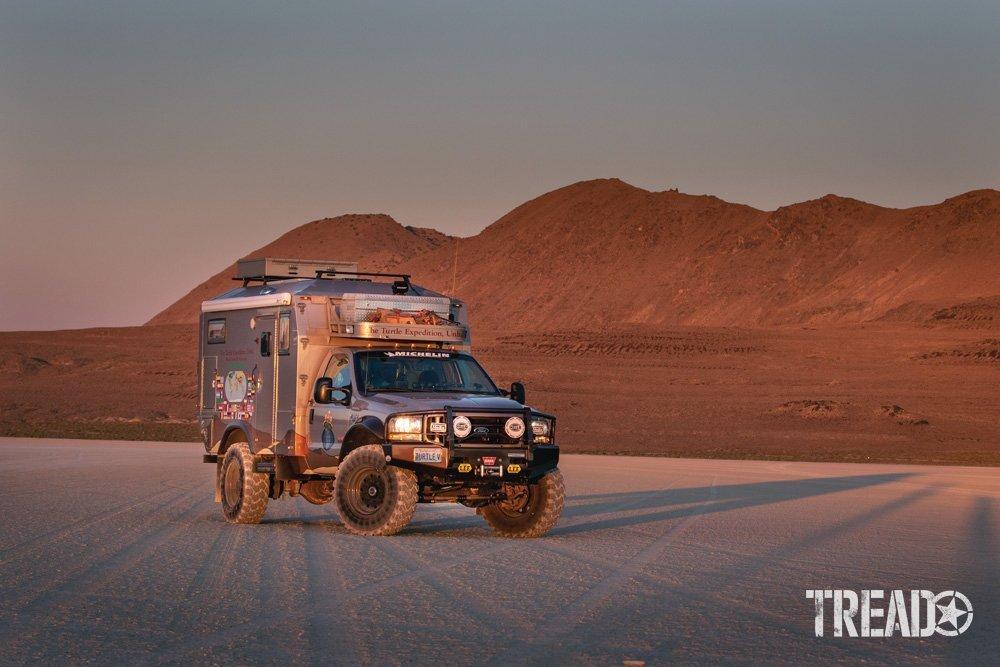 A overlanding 4x4 camper posed during golden hour