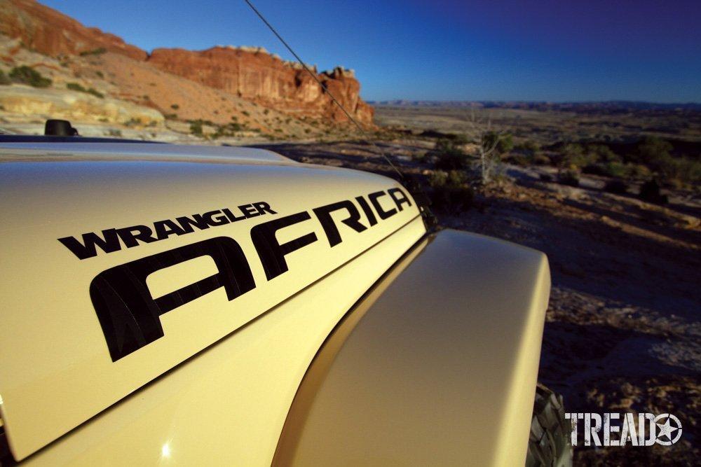 Jeep Wrangler hoot shot against rocky landscape