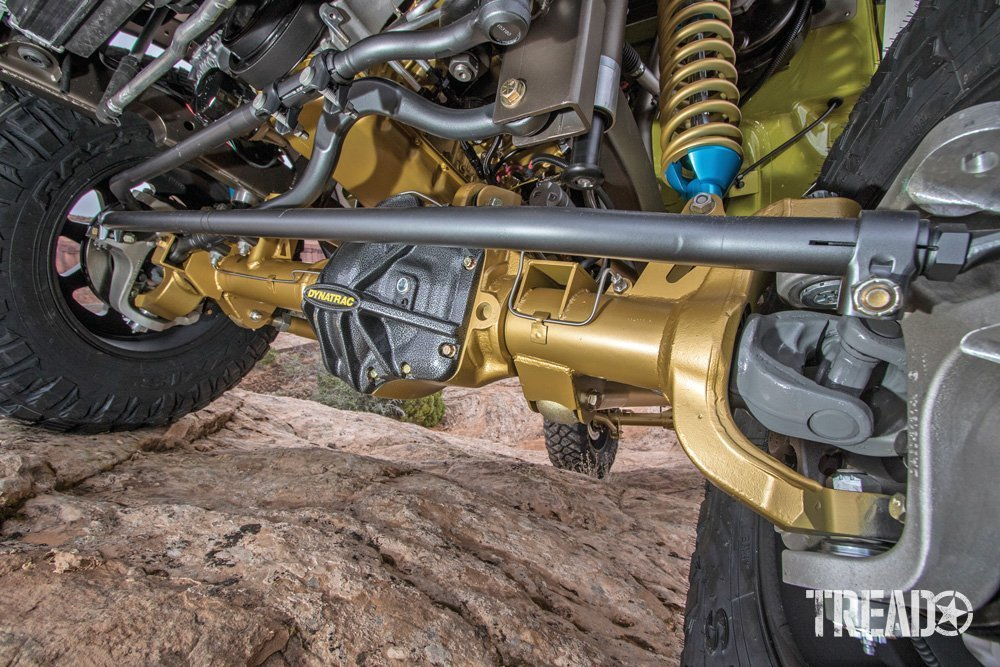 Image of undercarriage of a vehicle with gold axle.