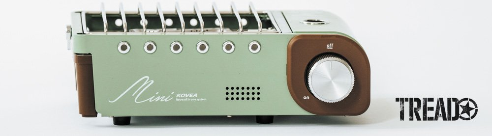 The KOVEA All-in-One Mini Stove has a mint green body with dark brown and chrome accents, it is retro looking.