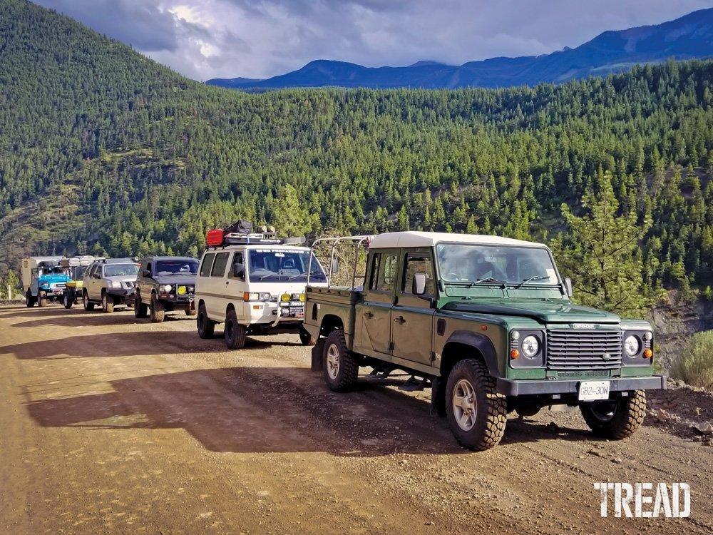 Land Rover Defender 130, Mitsubishi Delica and Pajero, a Nissan Xterra, and a Toyota FJ40