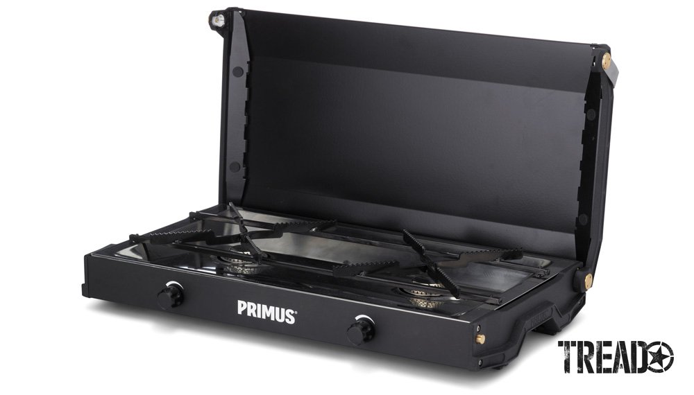 The black Primus Kinjia 2-Burner Gas Stove is compact, has a hinged lid, and is ready to cook.