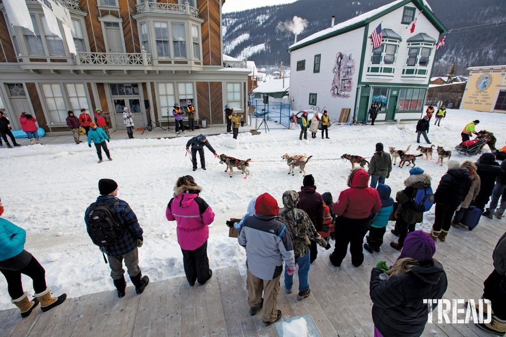 A dogsled team leaves the starting line at the Percy DeWolfe dogsled race.