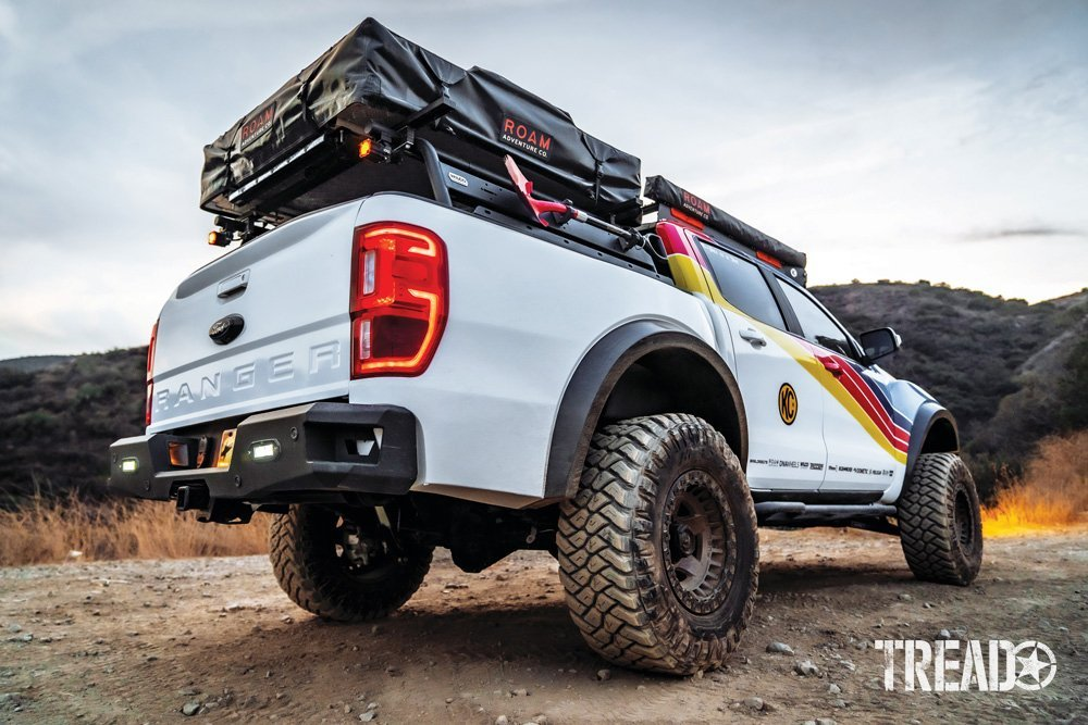 2019 Ford Ranger beauty pose details the bed rack with red shovel and rooftop tent.