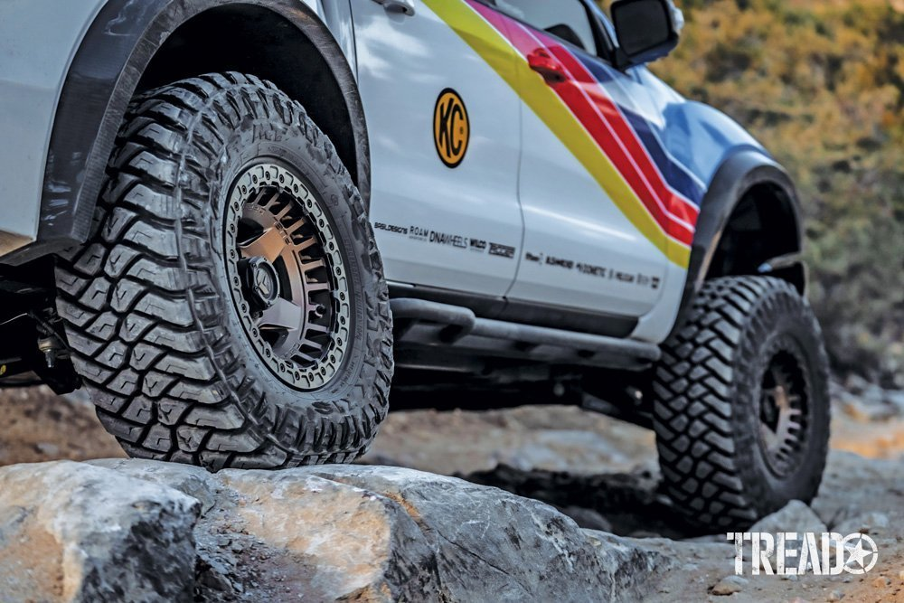 The 2019 Ford Ranger showcases knobby Maxxis RAZR M/Ts with bronze-colored Fuel Offroad Warp Beadlock wheels.