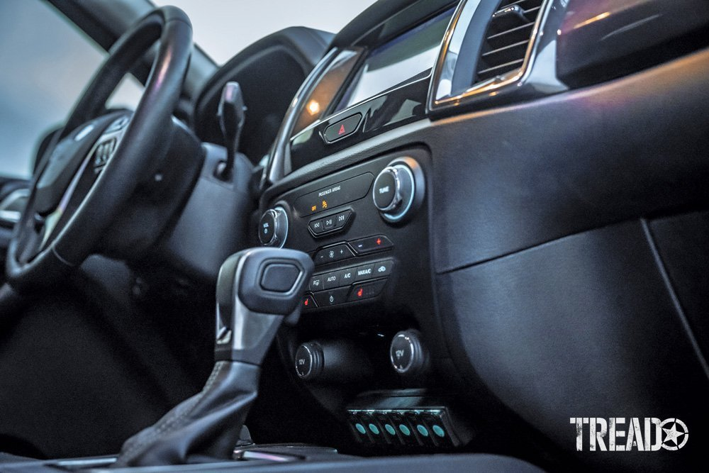 The interior of the 2019 Ford Ranger shows a black and dark gray assortment of materials and buttons.
