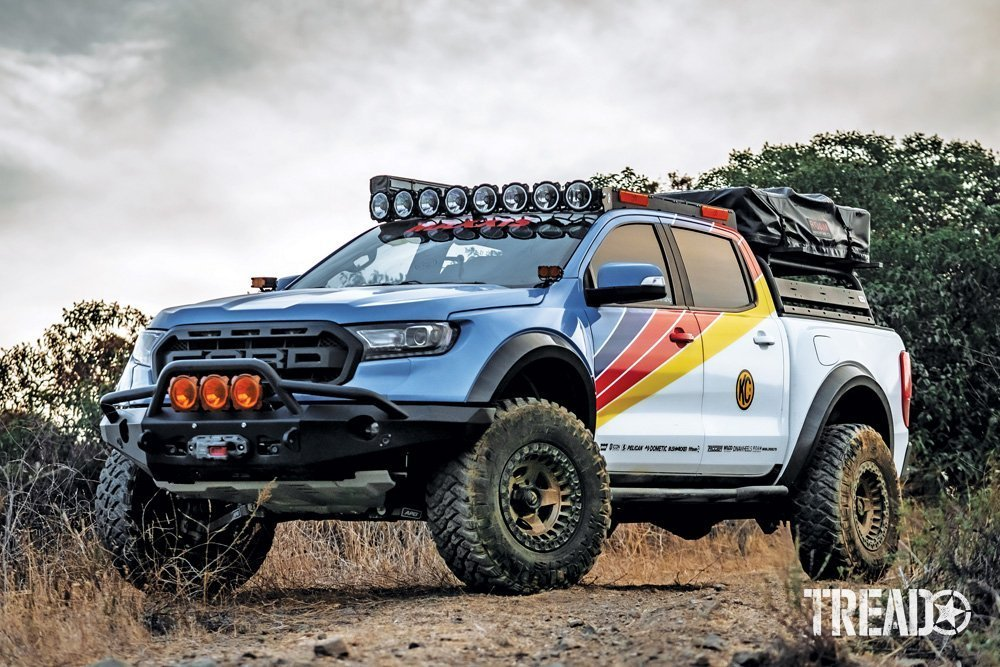 2019 Ford Ranger is loaded up with gear, it's multi-colored striped sides and tons of aux lights accent this off-road truck.