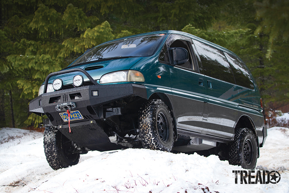 The author's teal and gray Mitsubishi Delica Space Gear traverses snowy trails after the tank was installed.