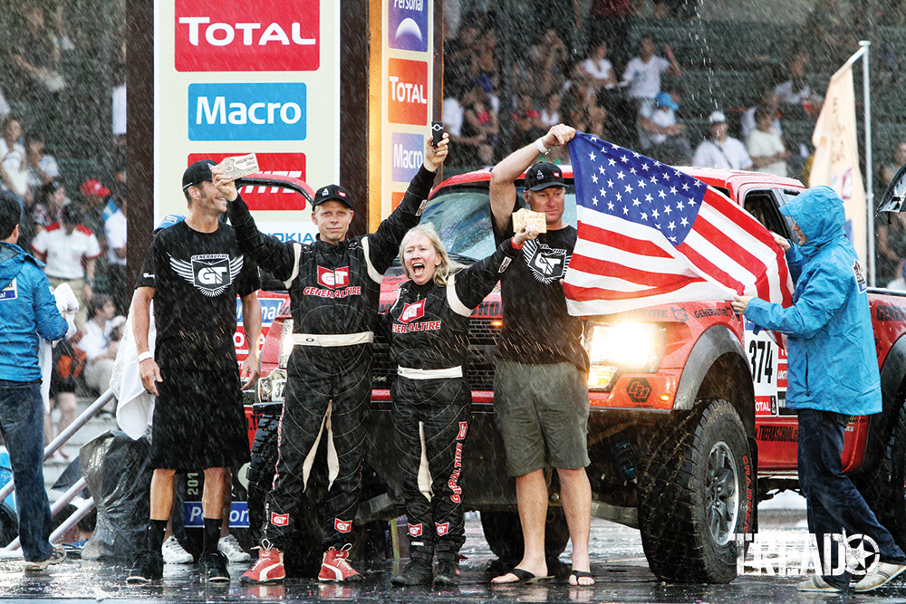 Celebrating on the podium in Buenos Aires, Argentina, was Sue Mead. She was the driver of record with the Ford Raptor USA team (one women, three men) winners of the Open Production Class in the 2011 Dakar Rally as it poured).