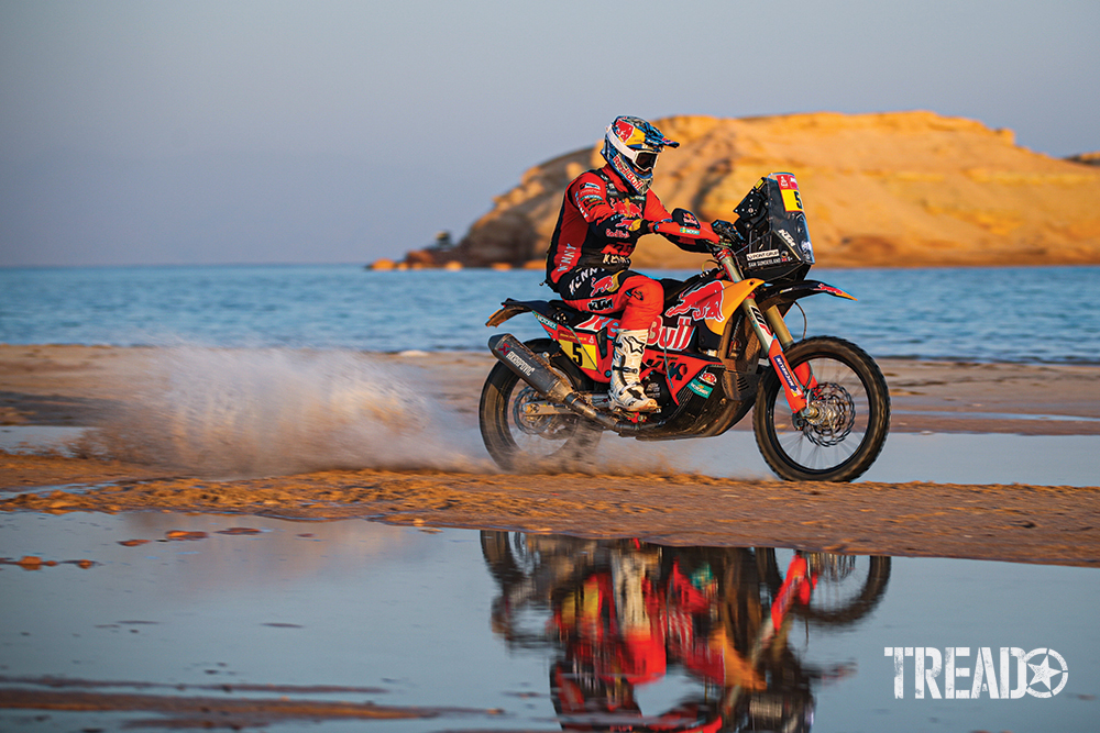2021 Dakar #05 Sunderland Sam (gbr), KTM, Red Bull KTM Factory Team races through water on a dirt trail.