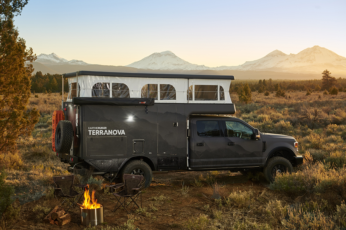 Black truck and Terranova camper with pop top open