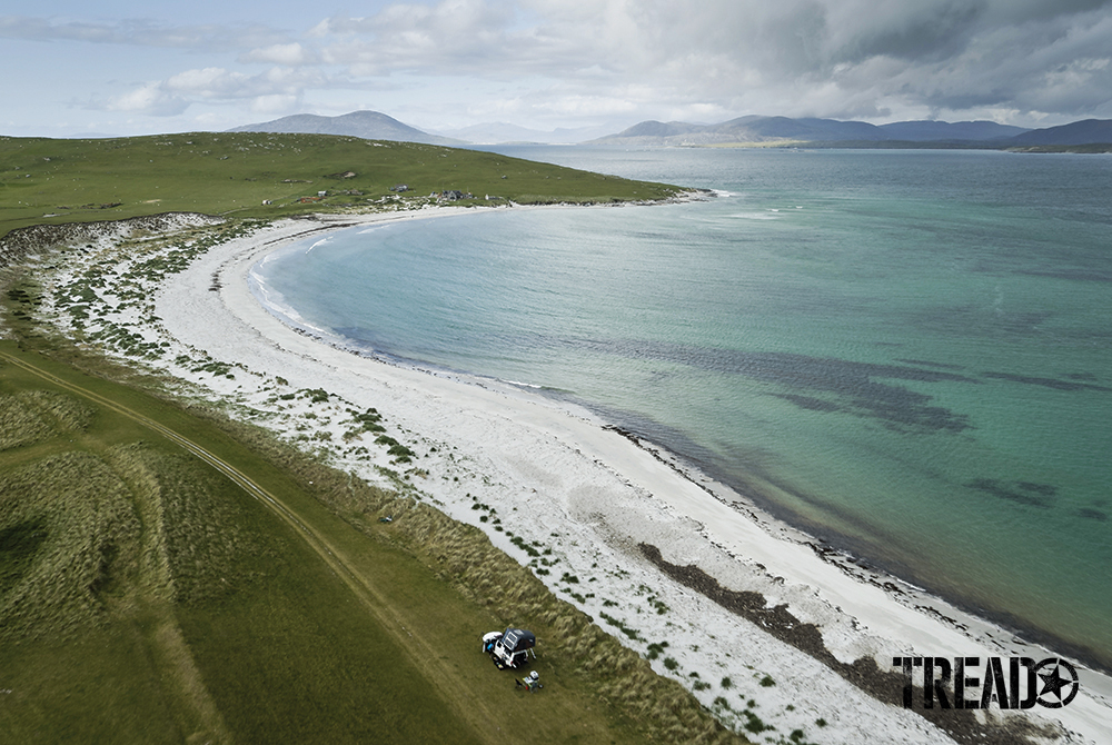 The Scottish Highlands offer beautiful light-colored sand beaches next to green plains and hills.