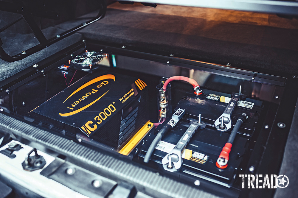 2006 E350 Super Duty 4x4 inverter and battery is neatly packed into an in-floor cubby in the van's interior.