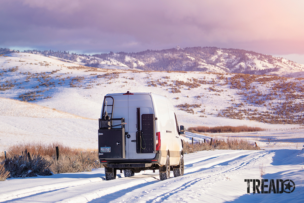 This white third gen Sprinter van is equipped with a 39-gallon LRA replacement tank and drives in Idaho hillsides.