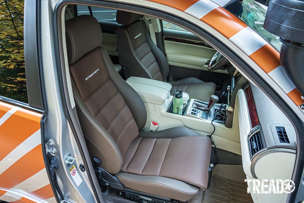Brown Scheelman seats are shown for driver and front passenger, which replaced factory seats.