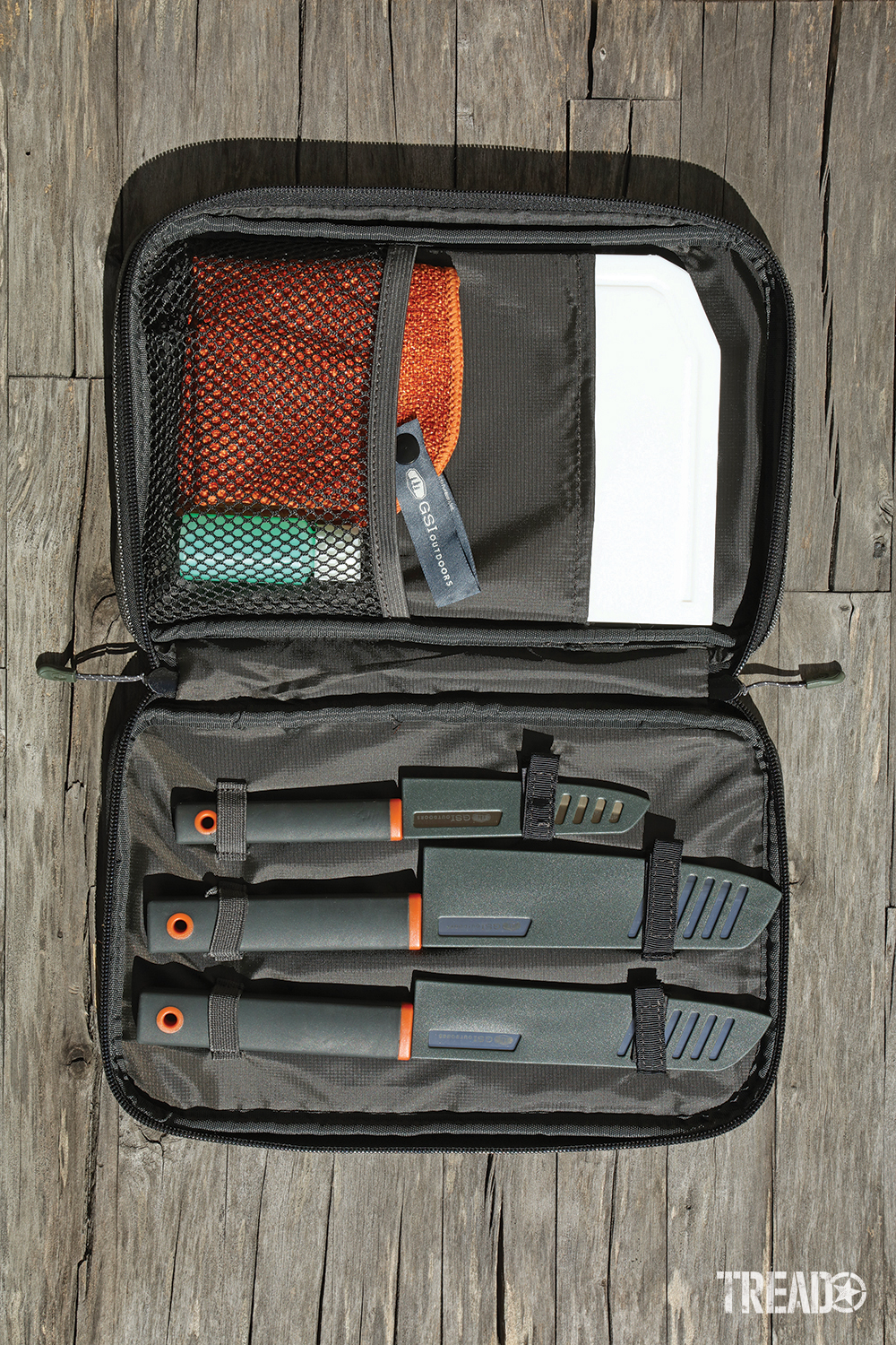 Each dark gray knife and items stow neatly in the GSI Santoku Knife Set zippered carry bag.