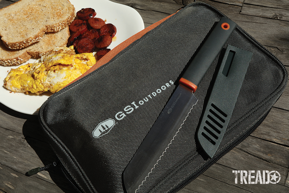 The Santoku knife set, with dark gray handles, sheath covers and bag, is a complete kit that can help you camp cooking happily.