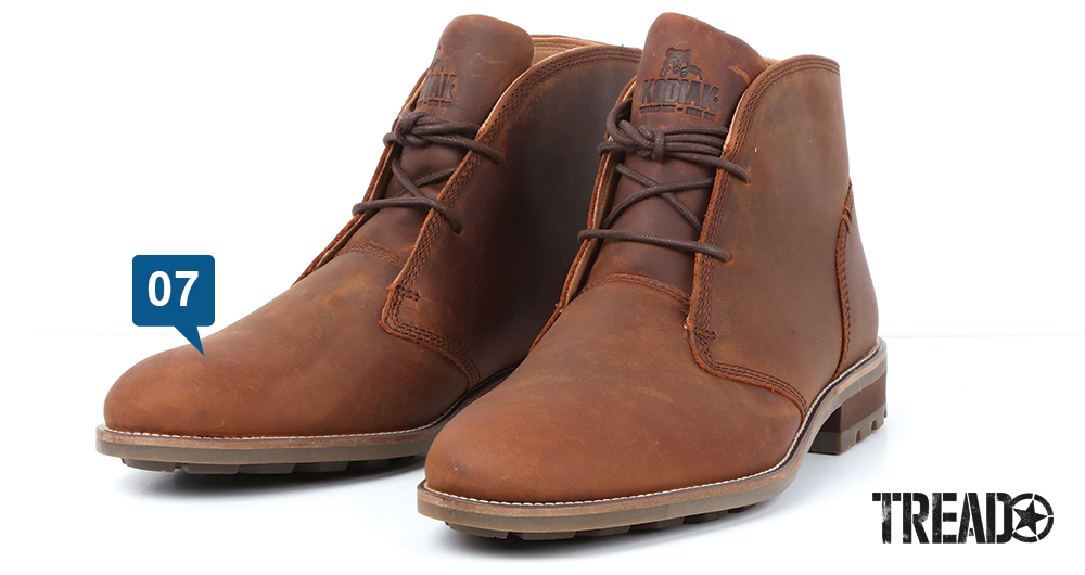 The brown Kodiak/McKernan Chukka Bootmen's hiking boot offers thin laces and soles, with a chunky heel.