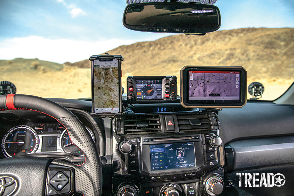 Customized 2017 Toyota 4Runner's dash houses an ICS Fab dash mount with dual charger connects the Garmin Overlander and iPhone, held with a Ram Mounts Quick-Grip waterproof, wireless charging holder.