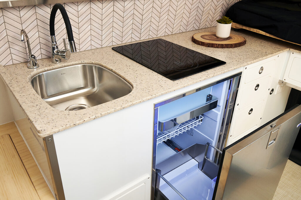 kitchen galley area of camper with refrigerator
