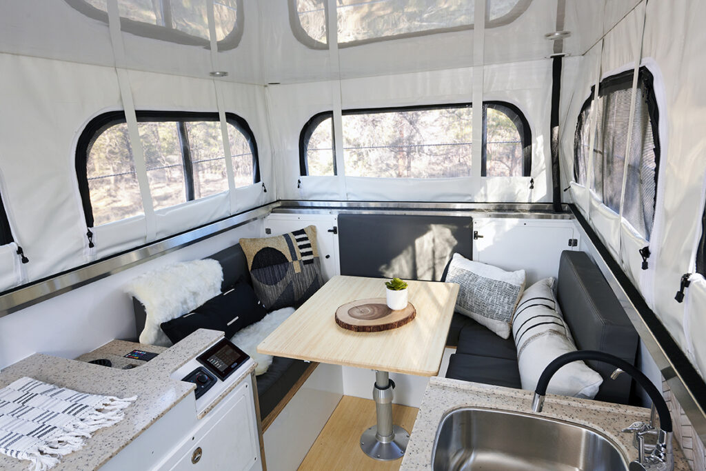lounge area with table and seats set up in camper