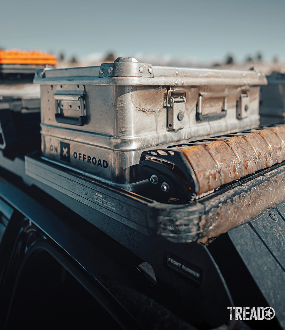 Tucked behind an ice-covered Front Runner roof rack and Rigid Adapt lightbar, the A042 Aluboxes provide extra storage up top for recovery gear and other necessities.