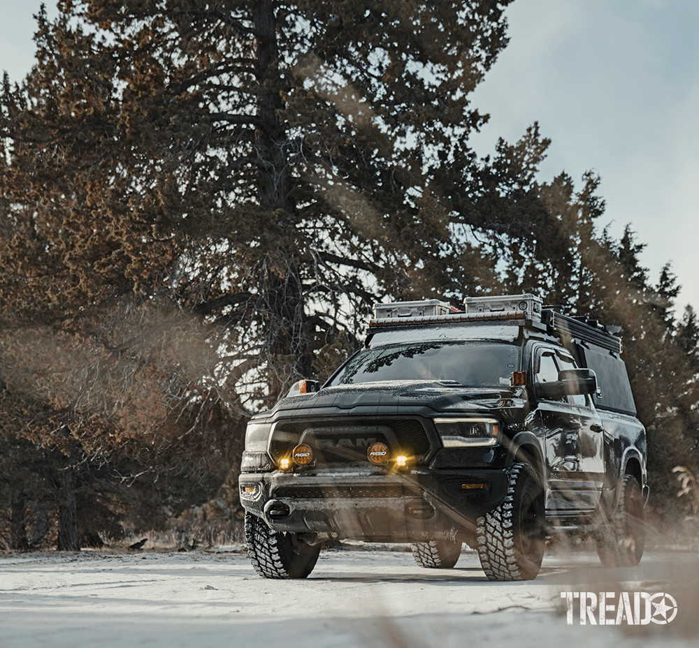 This capable RAM 1500 Rebel EcoDiesel Rebel 4x4 is plenty capable, even in the snow (with tall pine trees behind it).