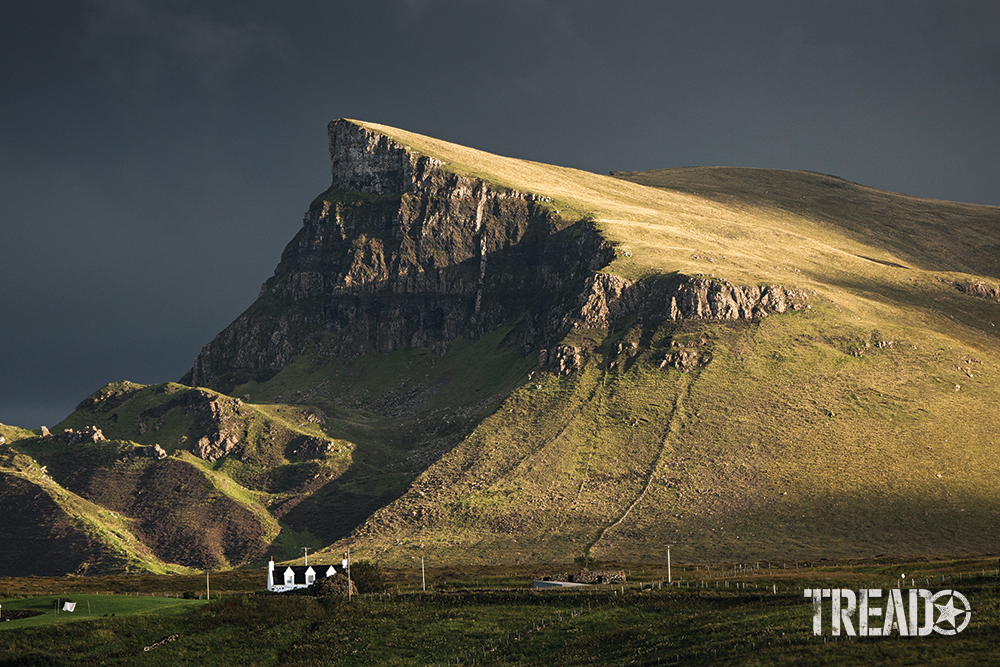 Scotland offers cliff-facing, lush hillsides, like this one that points to an angry gray sky.