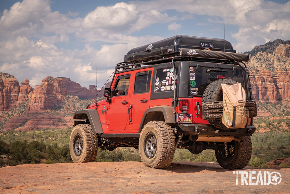 This Jeep peers out over the red rocks of Sedona Arizona along the Broken Arrow trail. It is a popular destination for off-roaders, hikers and sight seekers.