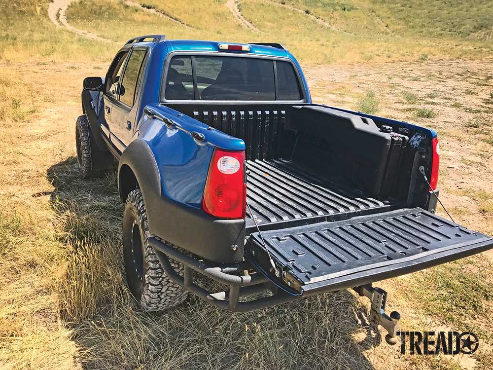 This Titan SideKick gasoline transfer tank is mounted in a blue and black Ford Sportrac Prerunner.