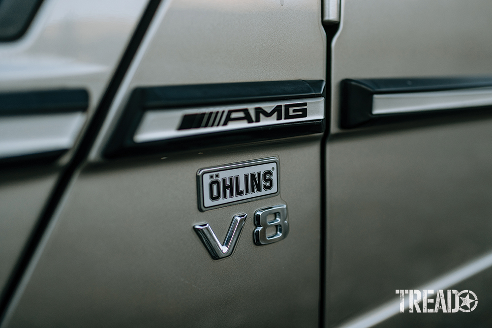 Black and white decals on the silver Mercedes G-Wagen.