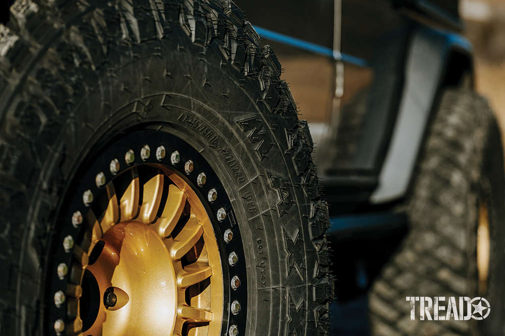 Maxxis Razr tires, wrapped around gold OMF beadlock-converted Rays TE37 wheels, complete the look of this Mercedes G-Wagen build.