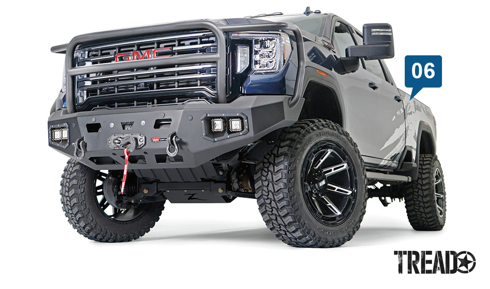 WARN/Ascent HD Front Bumper For 2020 GMC 2500/3500 has a full brush guard and is powdercoated black. It also has allowances for aux lights and a WARN winch.